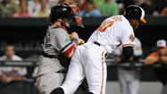 Adam Jones doesn't shy away from contact in collision with Red Sox catcher
