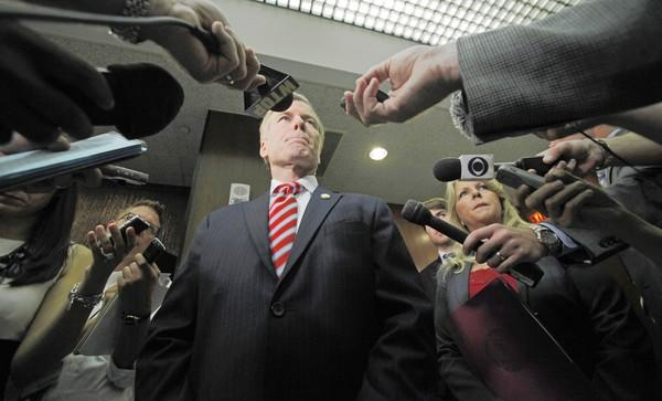 Virginia Gov. Bob McDonnell talks with members of the media after announcing a state budget surplus to the General Assembly Appropriations and Finance committee members at the General Assembly Building in Richmond on Wednesday.
