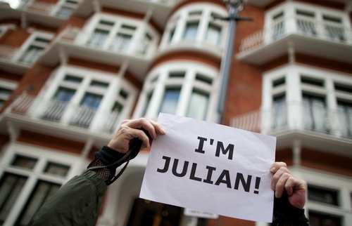 A supporter of Julian Assange outside the Ecuadorean Embassy awaited Ecuador's decision to grant asylum Assange.