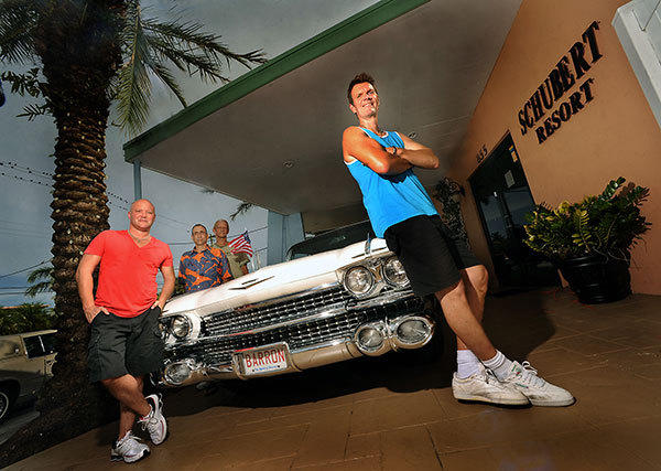 Members of the Flamingo Auto Group South, a gay car club in South Florida.  At left front in red shirt is club president Adam Walder, and behind him at left is Jim Medeiros at center and Joe Mackiewicz, and at front right is Bob Barron, who owns the Cadillac Fleetwood.