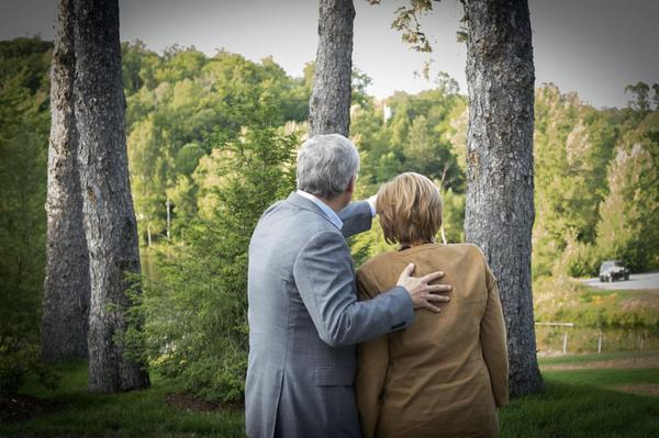 Canada's Prime Minister Stephen Harper (L) talks with Germany's Chancellor Angela Merkel at Harrington Lake, Harper's official country retreat, in Gatineau Park, Quebec August 15, 2012. Merkel is on an official visit to Canada.