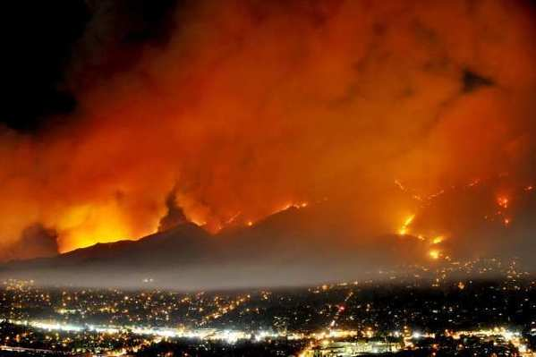 The Station fire burned 160,000 acres of the Angeles National Forest and set off a tense debate over whether the U.S. Forest Service should use night flights to battle blazes. On Thursday, Aug. 16, 2012, the agency agreed to restart night flights decades after abandoning them for safety reasons.