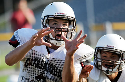 Catasauqua's Eric Matz goes for a pass at practice Thursday morning.