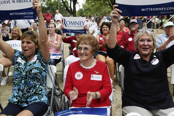 Carla Margis, left, Alma Toedter, and Susan Thorton cheer House Republican Leader Tom Cross during Republican Day at the Illinois State Fair in Springfield.