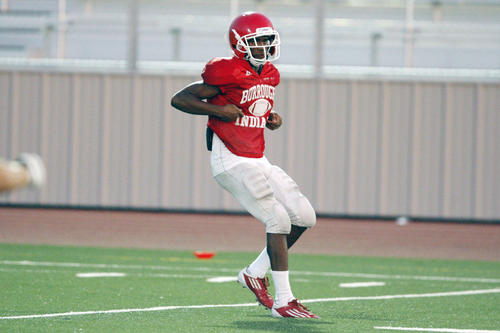 Burroughs' Oharjee Brown runs through a play during practice at John Burroughs High School in Burbank on Wedesday, August 15, 2012.