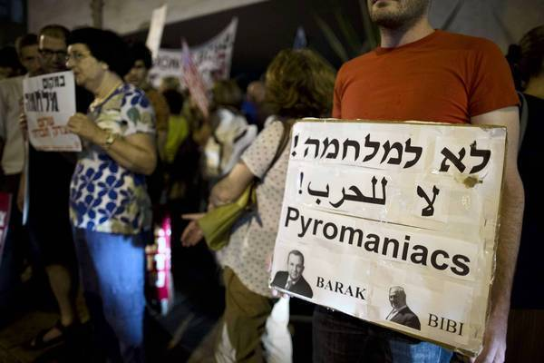 Israelis protest in Tel Aviv against a threatened Israeli military strike on Iran.