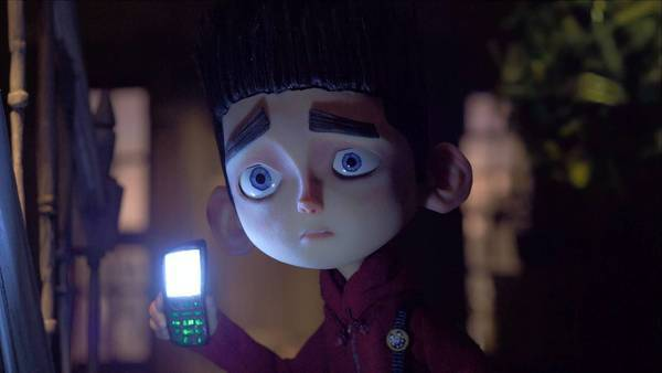 "Norman (voiced by Kodi Smit-McPhee) searches Mr. Prenderghast's house in ""ParaNorman."""