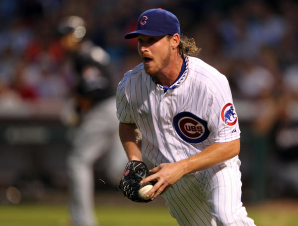 Travis Wood goes for the Cubs on Friday in the opener of a series against the Reds.