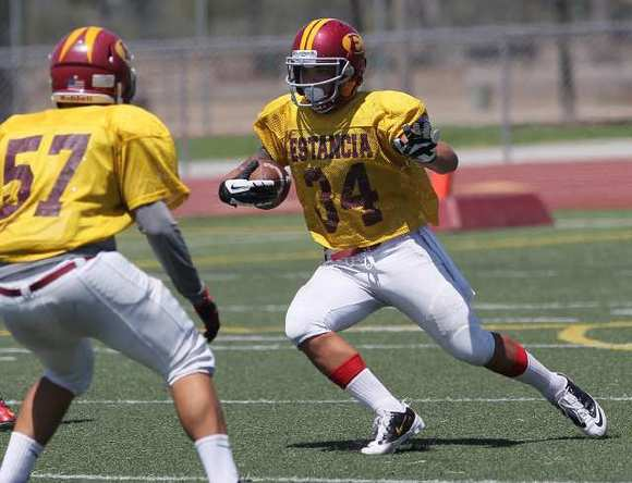 Estancia High senior Robert Murtha, right, is in position to break the Newport-Mesa School District record for career rushing yards. Murtha has rushed for 3,895 yards and is 439 yards away from breaking the Newport-Mesa district record.