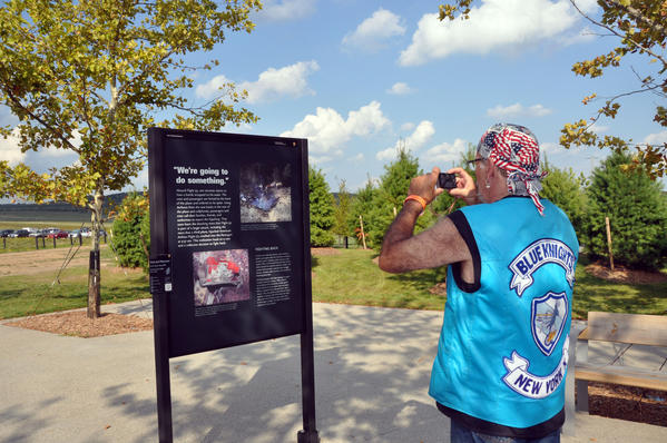 Sam Sampogna of New York takes a photo of one of the informational boards at the Flight 93 National Memorial.