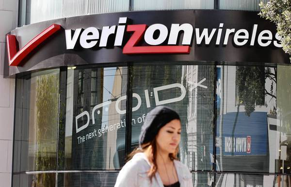 Verizon got approval from the Justice Department for its $3.6-billion purchase of wireless spectrum from the cable industry--with caveats.