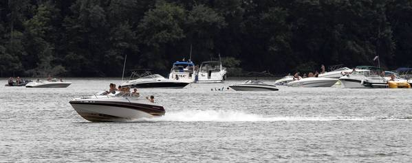 Boaters were cruising Petite Lake the day after 10-year-old Tony Borcia was struck and killed on that part of the Chain O' Lakes by a speedboat in July. A Bartlett man faces reckless homicide and DUI charges in the incident.