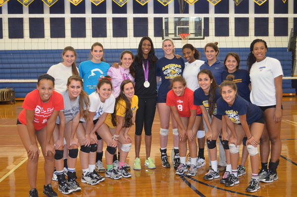Former St. Thomas Aquinas volleyball star Foluke Akinradewo, a member of Team USA which one the silver medal in London earlier this month, stopped by her alma mater for a surprise visit on Thursday.