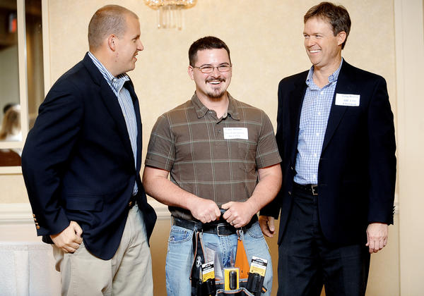 Luke Dubois, center, of Hagerstown was named the Electrical Apprentice of the Year Thursday night during the ABC Apprenticeship Graduation ceremony held at the Hagerstown Hotel & Convention Center. Jonny Barr, left, V.P. of Ellsworth Electric, Inc. and Greg Brown, right, of Waynesboro Construction and Chairman of ABC.