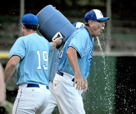Hellertown's #19 Ryan Amey and #21 Chris Sule dump ice water on their coach Bob Zerfass after they defeat Easton in the Blue Mountain League Championship Series Game 5 held at Dimmick Park on Thursday.