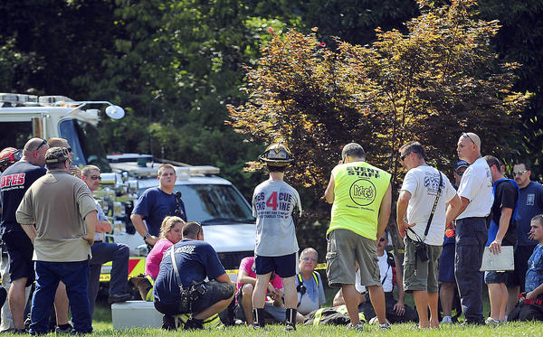 Emergency personnel gather Thursday at a Fairplay residence where a man became trapped in a trench that collapsed behind the home. The man was able to free himself about an hour after rescue crews arrived.