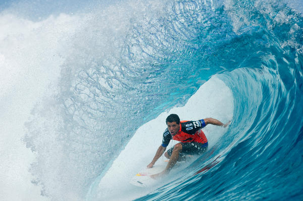 Adriano De Souza of Brazil of Hawaii in action to win his round one heat at the Billabong Pro Tahiti in Teahupoo. John John Florence of Hawaii defeated Miguel Pupo of Brazil and Pat Gudauskas of the US to advance straight to round three.
