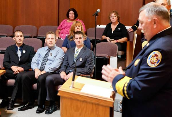Bethlehem Fire Chief George Barkanic (right) addresses the audience during the swearing-in of new fire department recruits (from left) Brett Knerr, Alfred Saks and James Sprague at Bethlehem City Hall on Wednesday morning.