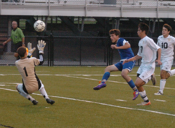 Mercer Countys Daniel Steele lofts a shot past Boyle County goalkeeper Bailey Snow for the Titans first goal Thursday in their 6-0 win over the Rebels. Steele scored twice.