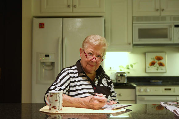 Barb Shaeffer, 85, works on one of the two crossword puzzles she does every morning in her kitchen in Chicago. Shaeffer is part of a Northwestern study of SuperAgers, elderly people who continue to stay cognitively sharp even as they age.