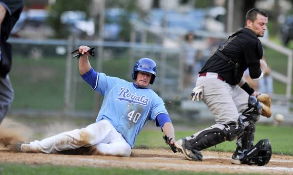 Hellertown's #40 Mark Angelo scores the game-winning run as Easton's catcher #Kyle Dauscher reaches for the ball in the Blue Mountain League Championship Series Game 5 held at Dimmick Park on Thursday.