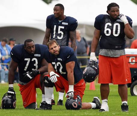 Offensive linemen J'Marcus Webb (73), Gabe Carimi (62), Lance Louis 60) with receiver Brandon Marshall (15).