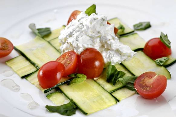 "<a href=""http://articles.latimes.com/2012/aug/18/food/la-fo-calcook-rec3-20120818"">Recipe: Woven zucchini with fresh goat cheese.</a>."