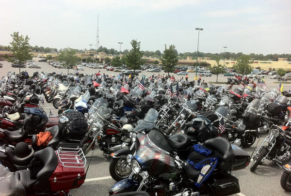 Some of the approximately 600 motorcycles taking part in America's 9/11 Ride fill a parking lot at Hagerstown Prime Outlets while their riders stopped for lunch Friday.