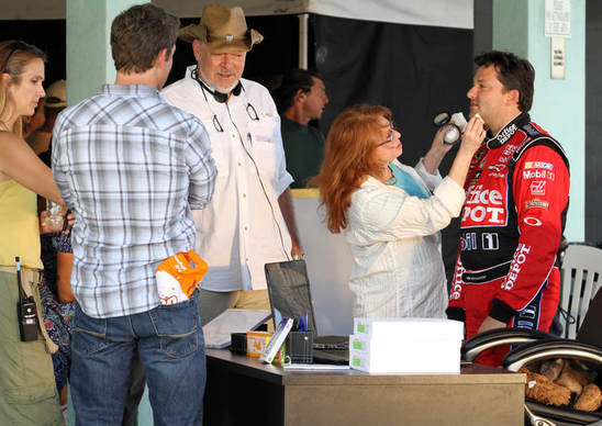 NASCAR driver Tony Stewart gets his makeup touched up on the set of The Glades.