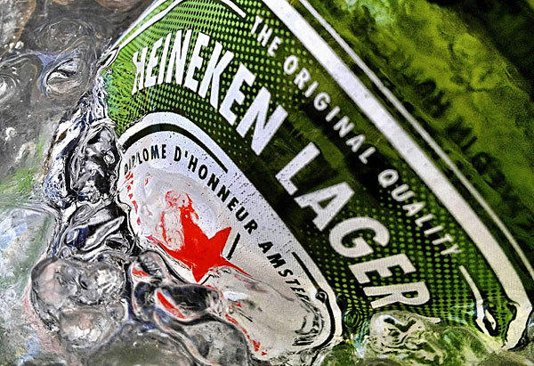Heineken NV is negotiating with Singapore's Fraser and Neave (F&N) about raising its $6 billion bid for full control of the maker of Tiger beer and breweries in 14 countries as it fights against a Thai billionaire for its future in Asia.