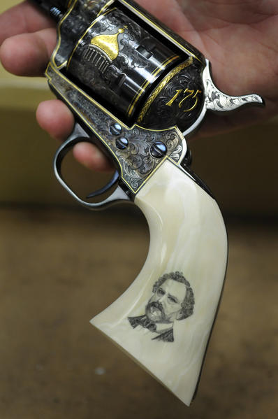 A custom Colt 45 single action built to commemorate the company's 175th anniversary has one of a kind hand tooling and a scrimshaw handle depicting Samuel Colt.