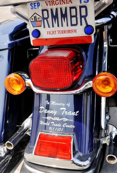 One motorcyle shows it's honor to one that died at the World Trade Center on 9/11.