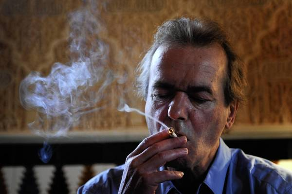 British writer Martin Amis smokes during his conference at Alhambra Palace Hotel during day three of the Hay Festival Alhambra on May 10, 2009 in Granada, Spain.