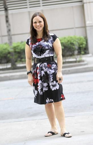 """Beauvais, 34, is a physician assistant, transplant surgery<br> <br> <b>Is that a new dress for the great weather?</b> """"I bought it like a week and a half ago. I bought three other spring dresses — two of them floral, all at Macy's.""""<br> <br> <b>And I see the weather's brought out your flip-flops too:</b> """"I have very cute red heels I wear with this, but I don't wear them when I'm out and about."""""""