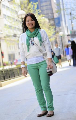 """Singvongsa, 28, is a financial administrator<br> <br> <b>Feeling </b>spring-y? """"I love warm weather. I'm just happy right now.""""<br> <br> <b>Do the sprout-green jeans have anything to do with your joyful smile? </b>""""I guess being fashionable makes me happy. I like being bold! This is just the second time I've worn them. They're from H&M."""""""