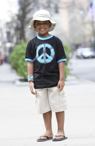 "Chase, 4, is a student at Kare Bear Academy<br> <br> <b>Nice hat! </b>(shy silence)<br> <br> <b>Are you always this quiet? </b>Dad Dino replies, ""He's going to talk me to death once we're out of here."""