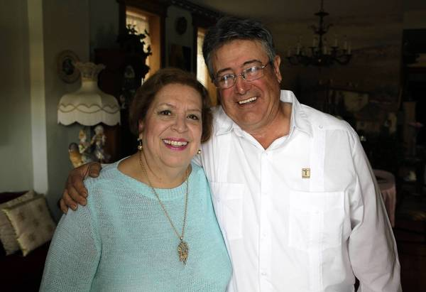 Elena and Ernesto Duran finally married after a decade of miscues. Elena wears the treasured pendant Ernesto bought on layaway after months of scrimping to surprise her on Mother's Day more than 30 years ago.