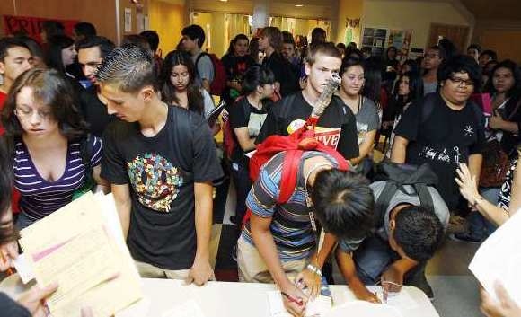 Students, outside the schools office, gather forms for schedule changes on the first day of school at John Burroughs High School in Burbank on Monday, August 13, 2012.