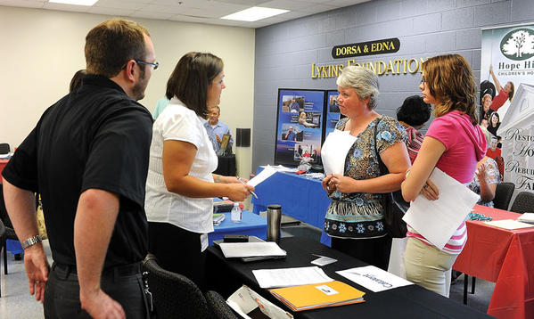 Jennifer Bishop, third from left, and her daughter, Rachael Bishop, talk with representatives of Catalent of Winchester during the 2012 Employment and Services Fair Friday at Bluegrass Community and Technical College. Speaking with the Bishops, who are both in the job market, are Jason Luring and Rachel Elmore.