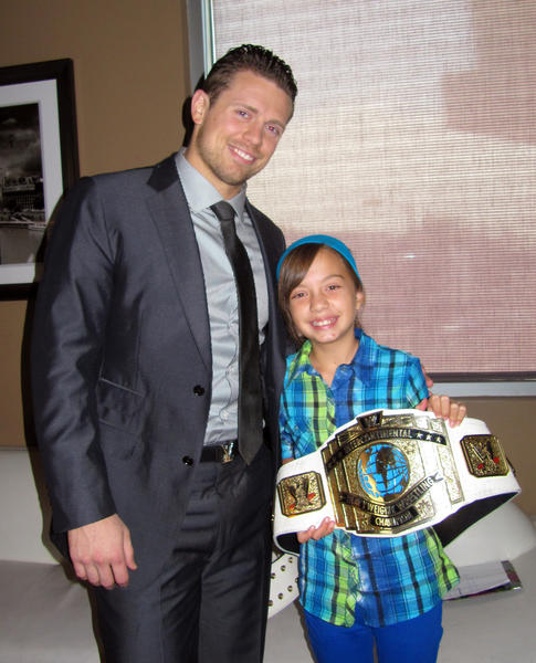 The Miz and Hannah Mitchell pose with the Miz's intercontinental championship belt.