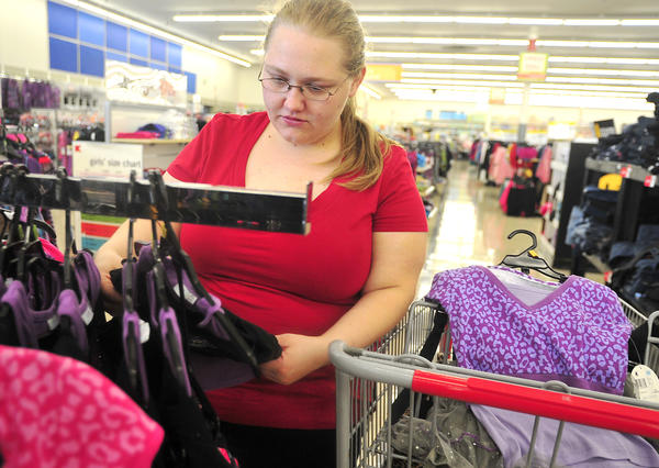 Tara Ensor of Hagerstown shops for her two children for back-to-school clothes and supplies at Kmart in Hagerstown Thursday.