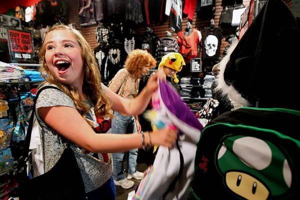 A super-excited Kaylee Vega, 13, spots a unicorn backpack inside Hot Topic at the South Bay Galleria in Redondo Beach.