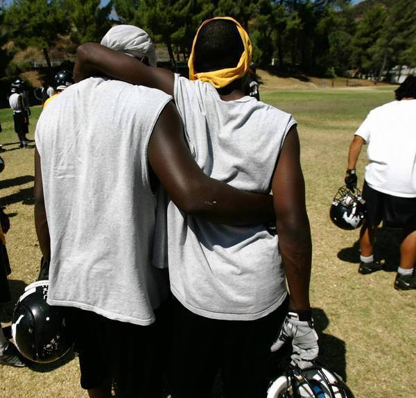 """Camp Kilpatrick teammates support each other at practice. The sports program at the juvenile detention center in the Malibu Hills -- the subject of the 2006 movie """"Gridiron Gang"""" -- may not return after the aging facility is leveled and rebuilt."""