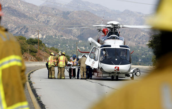 A crash victim is loaded onto an L.A. Fire Dept. helicopter for transport to a nearby hospital after the man was trapped when his truck collided with a big rig on the 210 Freeway southbound at La Tuna Canyon Rd. on the border of La Crescenta and Los Angeles on Friday, August 17, 2012.