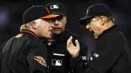 Showalter, Reynolds ejected after close play at first is overturned