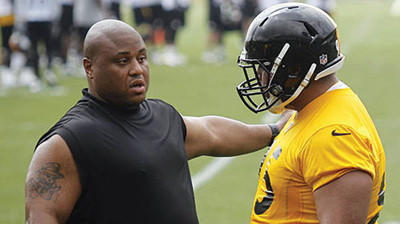 Veteran Casey Hampton, left, talks with rookie Alameda Ta'amu during the Steelers minicamp in June.