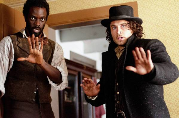 "Matthew Freeman (Ato Essandoh), left, and Detective Francis Magurie (Kevin Ryan) in ""Cooper."""