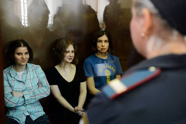 Members of the all-girl punk band Pussy Riot: sit in a glass-walled cage during a court hearing in Moscow on Aug. 17, 2012.