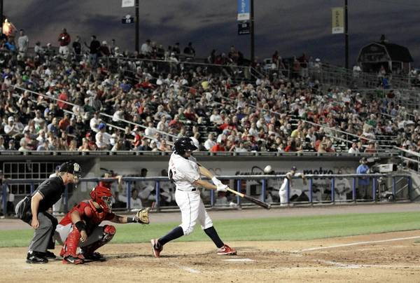 IronPigs #10 Cody Overbeck hits against the Pawtucket Red Sox at Coca-Cola Park on Thursday, August 2, 2012. The IronPigs have the best home record in the International League as they close in on the playoffs.