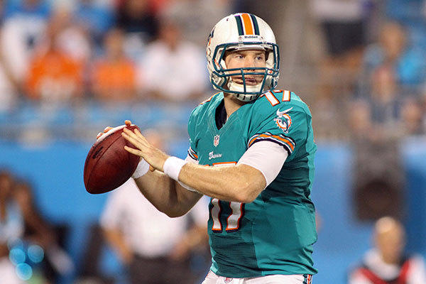 Miami Dolphins quarterback Ryan Tannehill (17) drops back to pass during the first quarter against the Carolina Panthers at Bank of America Stadium.